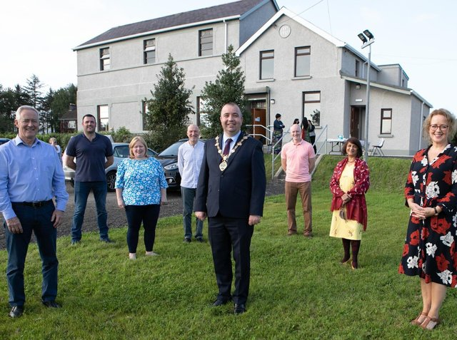 The Mayor of Derry and Strabane, Colr. Brian Tierney, pictured with staff, board members and volunteers outside the Victoria Hall in Culmore during a recent visit.
