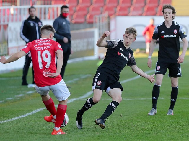 Derry City midfielder Ciaron Harkin charges down this attempted clearance by Sligo defender Regan Donelon. Picture by Kevin Moore.