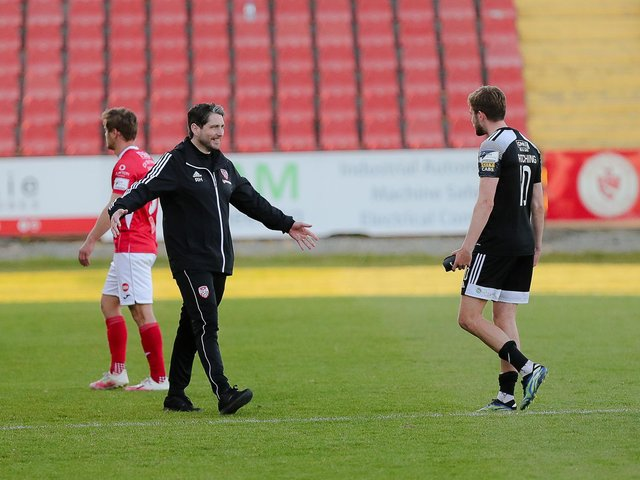 Derry City boss Ruaidhri Higgins is all smiles as he greets matchwinner Will Patching at the final whistle. (Picture by Kevin Moore).