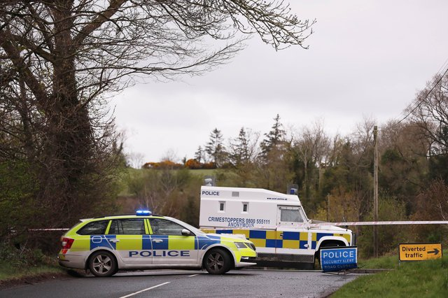 PSNI at the scene where a viable explosive device was left at the home of a female police officer near Dungiven.