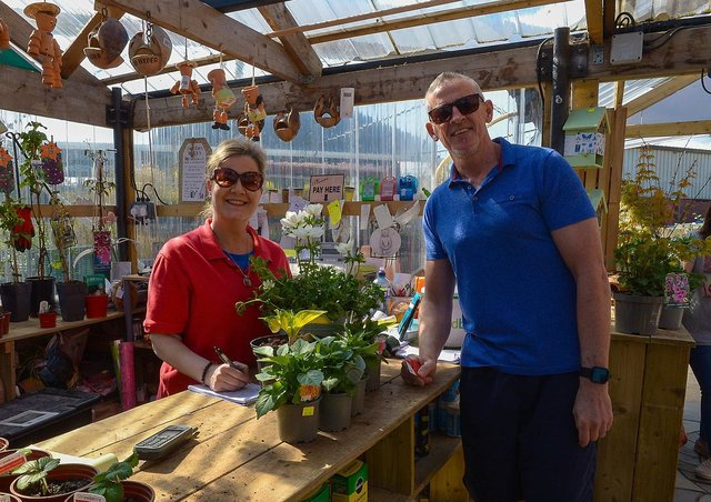 Leona Kelly serves customer John Fox at the Springrowth Landscape and Garden Centre, Springtown Industrial Estate. DER2115GS – 024
