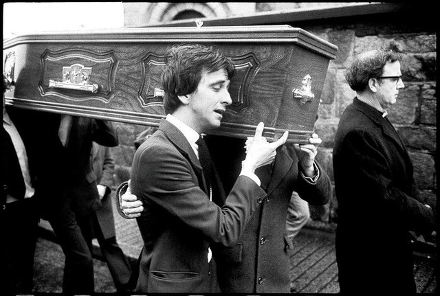 Paul Whitters' coffin is carried into St Columba's Church, Long Tower.