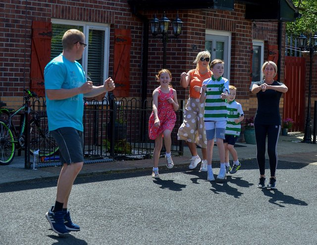 Families from Old City Close take part in Street Exercises, facilitated by the Brandywell and Bogside Health Forum, on Wednesday afternoon last. DER2220GS - 001
