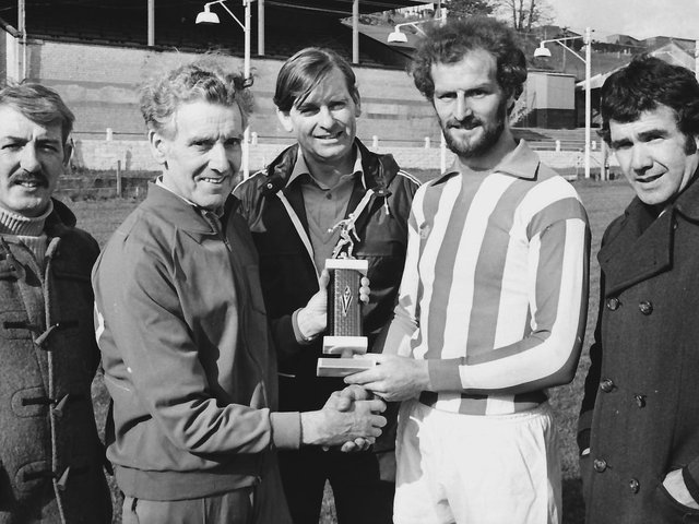 The late, great Terry Kelly, captain, Derry City FC, making a presentation on behalf of the club to trainer Dan Watson in recognition of his services to the Brandywell outfit.