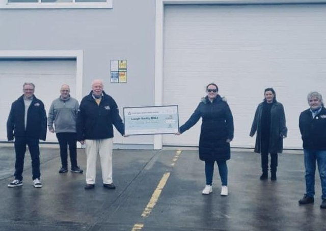 Members of Swilly Sound present the funds to Lough Swilly RNLI