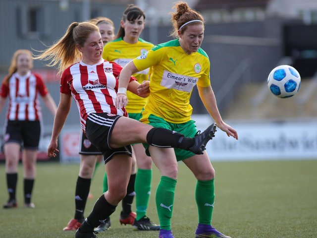Derry City Women's Alison McGonagle tussles with Cliftonville Ladies Marissa Callaghan during Wednesday night's game at the Brandywell. Picture by John Paul McGinley/JPJPhotography