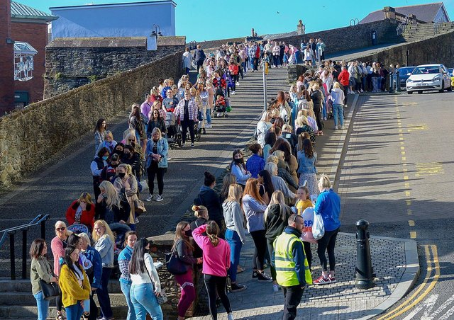 Hundreds of shoppers queue outside Primark on Friday morning as non-essential retails outlets reopen. Photo: George Sweeney / Derry Journal.  DER2117GS – 015