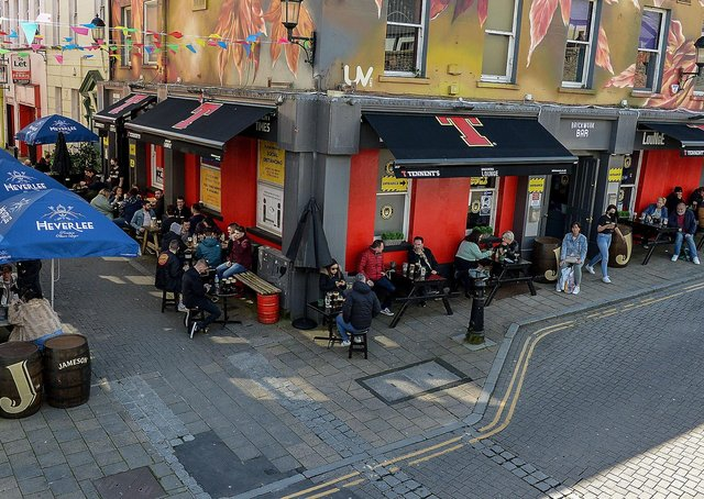 Customers enjoy the sunshine and a drink over the Bank Holiday weekend as lockdown restrictions were further eased on Friday last. Photo: George Sweeney / Derry Journal.  DER2117GS - 052