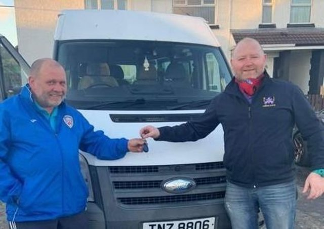 Stan Falconer handing over the keys to the minibus to Jason Hughes from NICC.