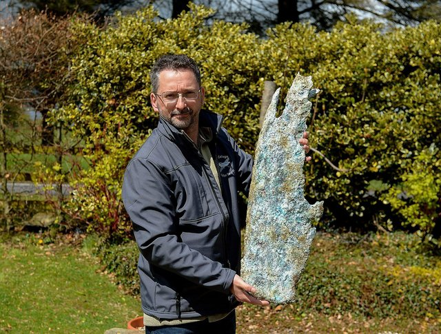 Jonny McNee holds a part of a propeller, recovered from the WWII Bristol Beaufort twin-engine torpedo bomber crash site at Ballykelly. DER2118GS – 002