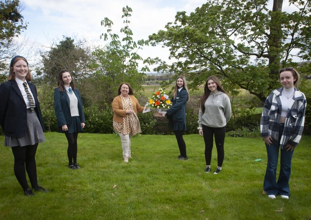 Georgia Donnelly presenting flowers to Sandra Biddle, Foyle School of Speech and Drama awards last week. Included from left are Eildh Oâ€TMConnor Abby O'Donnell, Aimee Doherty and Leah Curry. (Photos Jim McCafferty Photography)