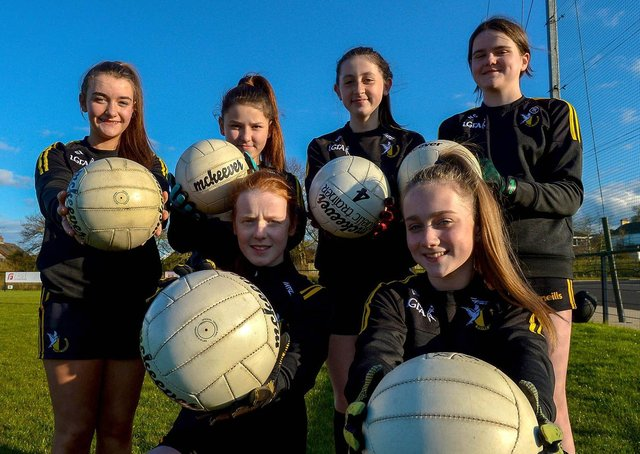 Girls from Doire Colmcille GAC happy to be training following the easing of lockdown restrictions. DER2115GS – 038