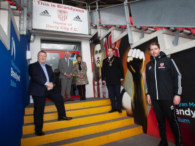 The Mayor of Derry City and Strabane District Council, Brian Tierney pictured with the late Mark Farren's parents Michael and Kathleen visiting their son's mural at the Ryan McBride Brandywell Stadium. Included on left is Philip O'Doherty, chair, Derry City and right, Ruaidhri Higgins, Derry City manager.