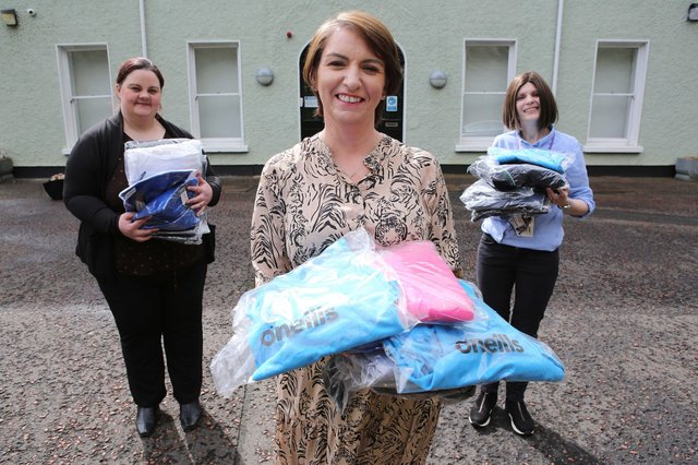 Orla Ward from O'Neills, presenting an initial batch of clothing to Foyle Women's Aid representative Joanne Miller (left), and Denise McQuillan, for The Rowan (SARC). The local sportswear manufacturer is donating hundreds of clothing items which individuals referred to the regional centre can change into when leaving.