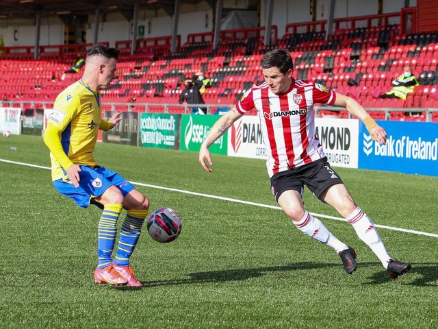 Derry City defender Ciaran Coll attempts to get past Longford's Dylan Grimes at the Ryan McBride Brandywell Stadium. Picture by Kevin Moore.