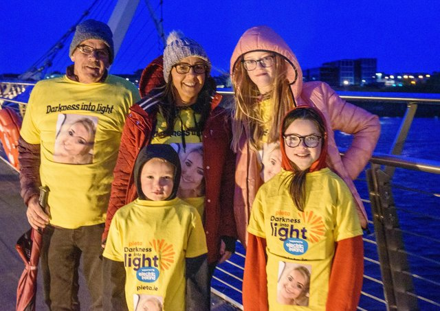 One Sunrise Together, Eugene McDaid with Jacob, Nicola, Keeli and Sophie, in memory of Simone, pictured in Derry during the Pieta Darkness Into Light 2021 sunrise walk supported by Electric Ireland. Thousands of people across Ireland joined together, while apart, under one sunrise on Saturday morning to offer hope to those impacted by suicide and to raise vital funds to ensure Pieta and its partner Northern Ireland charities can continue to provide their life-saving services.