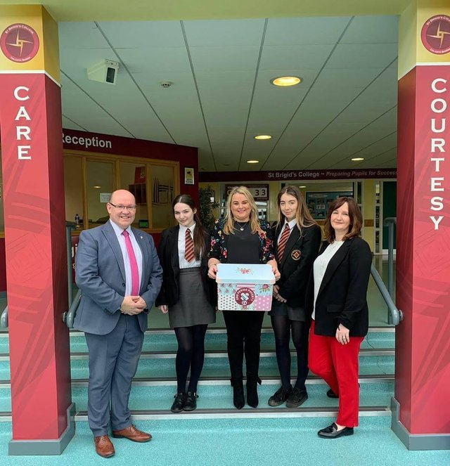 2019: Councillor Sandra Duffy with Mr McMonagle, Miss McCauley and pupils from St Brigids College delivering free period products.