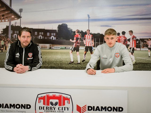 Derry City manager Ruaidhri Higgins and defender Ronan Boyce who has signed a contract extension keeping him at the club for at least another three and a half years.