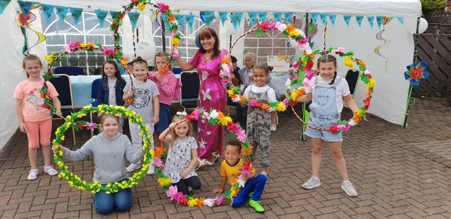 Margaret Cunningham pictured with local children at a previous community event in Hazelbank.