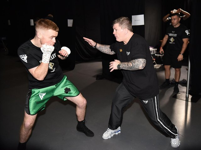 Brett McGinty receives his final instructions from trainer, Ricky Hatton ahead of his professional debut last December. Photograph by Christopher Dean for Hennessy Sports.