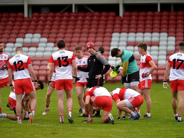 Derry manager Rory Gallagher talks to his players during last season's league game against Longford in Celtic Park.
