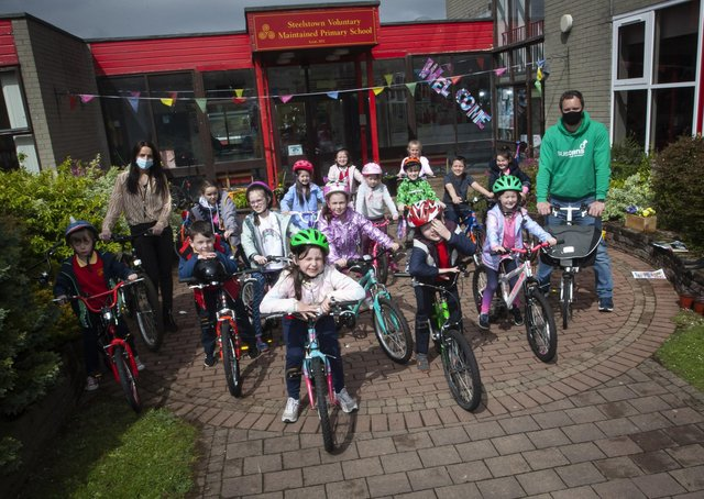 Steelstown Key Stage 1 pupils getting ready for their †̃Cycle Skillsâ€TM session with Sustrans Richard Farrow on Wednesday last. Included is Miss Bronagh Lynch.