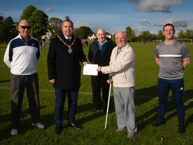 .The Mayor of Derry City and Strabane District Council, Brian Tierney pictured at Clooney Park West on Monday evening announcing the sponsorship of pitches for the Derry and District FA League this season to mark the organisation's centenary. Included from left are Willie Barrett, secretary, Liam Smyth, games organiser, Jimbo Crossan, chairman and Darren Smyth, match secretary. (Photo: Jim McCafferty Photography)