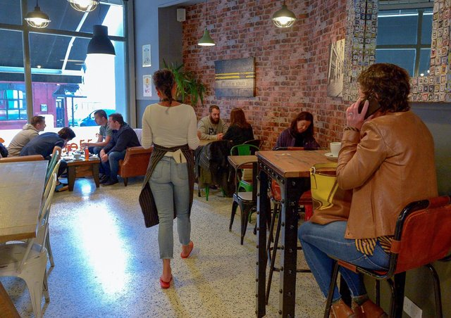 Customers pictured in the Scullery Café, Waterloo Street last summer. Children under 12 are not counted in the six per table maximum. DER2027GS – 001