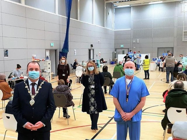 Mayor Tierney with health staff at Foyle Arena.