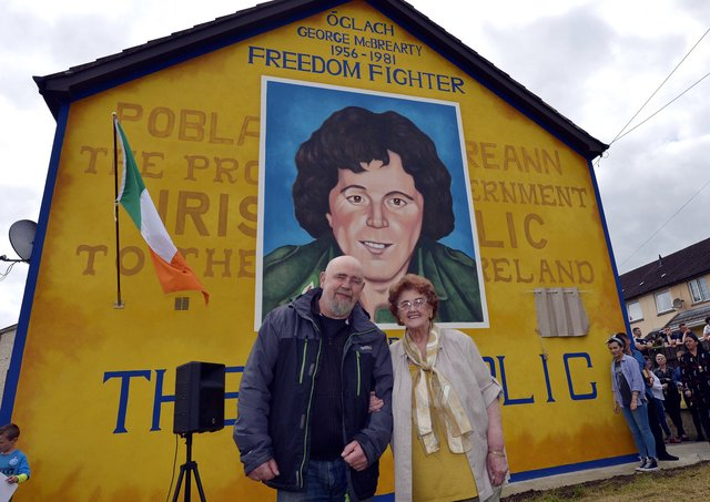 Mrs Bridie McBrearty pictured with Bogside Artist Kevin Hasson at the George McBrearty mural in Rathkeele Way at a previous commemoration. DER2217GS002