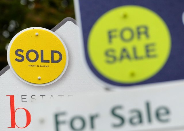File photo dated 14/10/14 of sold and for sale signs. House prices across the UK are expected to increase by 4 percent this year, according to a property group's forecasts. Issue date: Tuesday March 9, 2021.