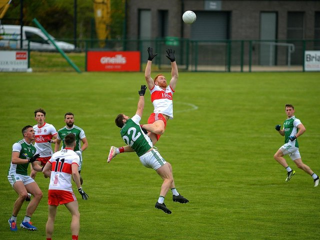 Derry's Conor Glass takes to the skies to win possession against Fermanagh at Owenbeg on Saturday. (Photo: George Sweeney)