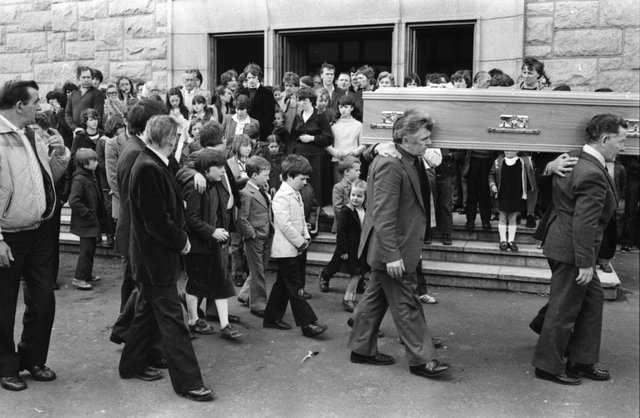 Harry Duffy's children follow his coffin as it is carried from St Mary's Church, Creggan.