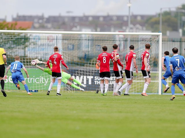 Nathan Gartside saves from Shane Griffin's free-kick at the end of the first half in Waterford. Photograph by Kevin Moore (Maiden City Images).