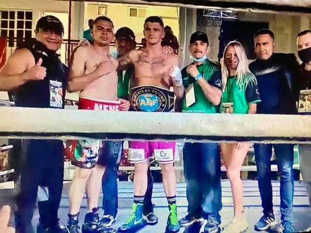 Connor Coyle pictured in the ring with his opponent Edgar Ortega, his coaching team and girlfriend Eva Vipartaite after winning the ABF Intercontinental Americas middleweight belt at the weekend.