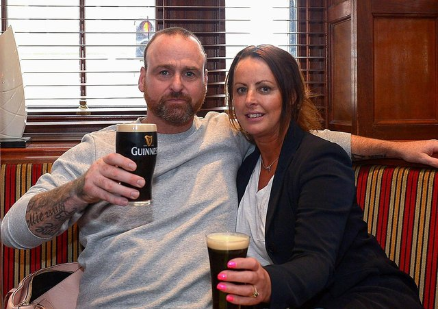 John Paul Doherty and Leona McKeever enjoy a lunch time Guinness in Badgers Bar and Restaurant yesterday afternoon as pubs reopened for indoor service. Photo: George Sweeney / Derry Journal.  DER2121GS – 001