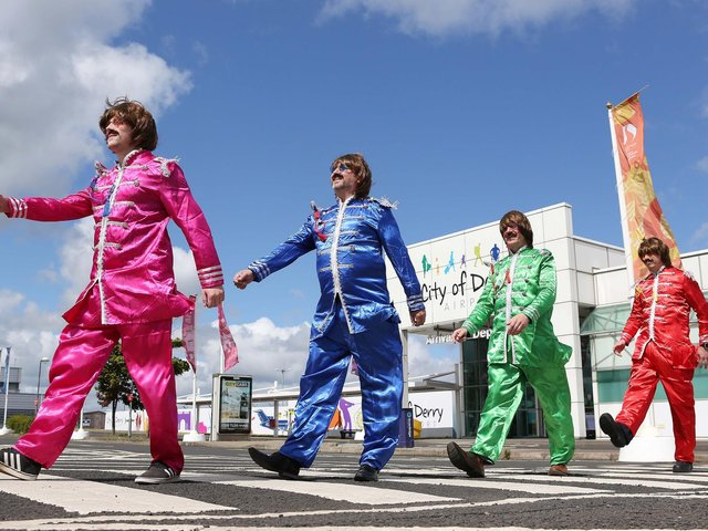 CODA Managing Director Steve Frazer and staff as The Fab Four in Sergeant Pepper costumes meets Abbey Road.