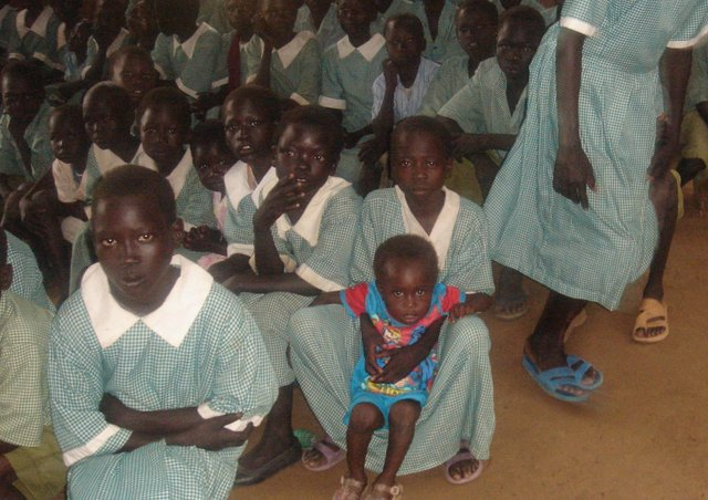Children in new uniforms paid for by local children.