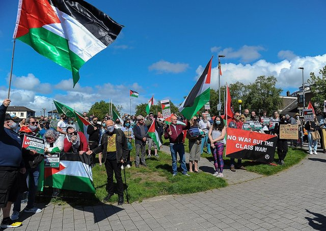 Some of the attendance at the Palestinian solidarity Rally at Free Derry Wall on Saturday after last. Photo: George Sweeney. DER2120GS – 070