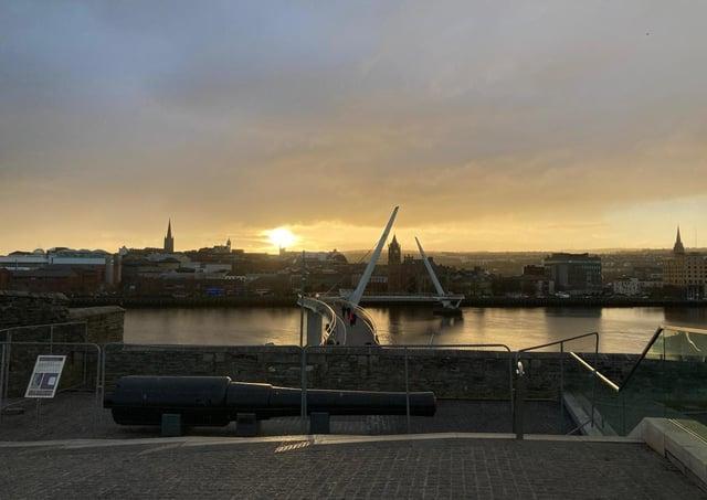 Derry city centre skyline at sunset.