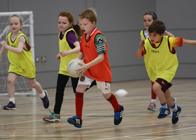 Youngsters pictured several years back during the Urban Gaelic Games Programme P4 Gaelic Football Blitz in the Foyle Arena. DER2315-129KM