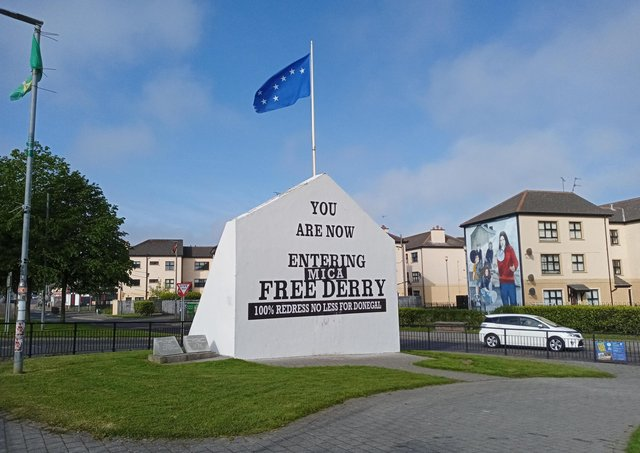 Iconic Free Derry Corner has been given a special make-over in solidarity with the families affected by MICA defective blocks across the border in neighbouring Donegal.