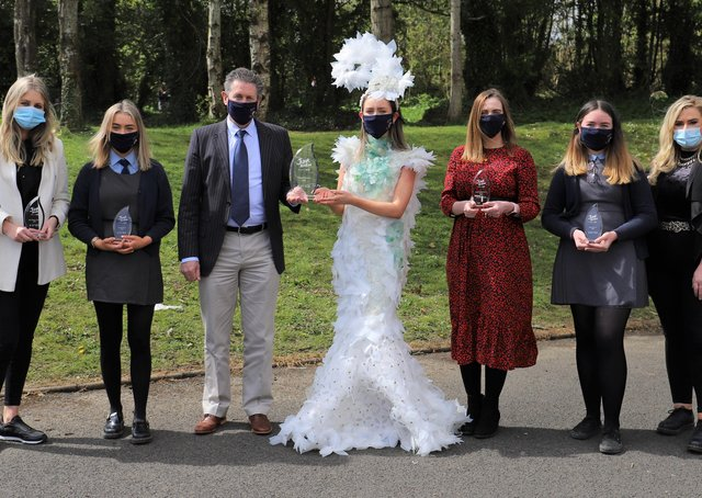 Carndonagh Community School's Mr McGuinness, Mrs. McDermott, Ms Bradley, Ms. McGee,  with Junk Kouture winners Robyn O'Donnell, Orlaith Doherty and Bronach Harkin as they received their trophy.