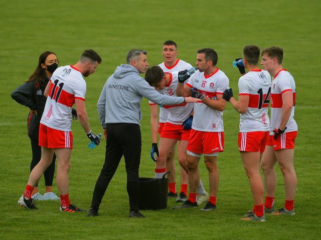 Derry manager Rory Gallagher talks to his players during the victory over Fermanagh at Owenbeg. (Photo: George Sweeney)