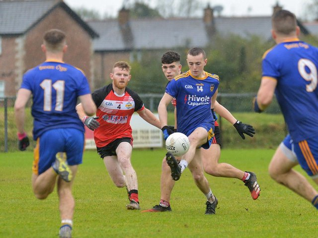 Steelstown Cahir McMonagle in action against Greenlough in last season's Intermediate Final. The Brian Ogs face a tough start away to Banagher, as do Greenlough who travel to Kilrea. (Photo: George Sweeney)
