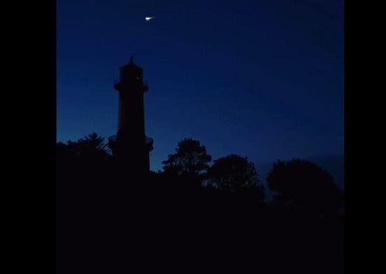A still from Eileen McLaughlin's video of the supermoon and meteorite over Shroove lighthouse in Co. Donegal.