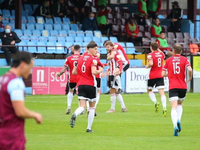 Will Patching celebrates after scoring the opening goal at Drogheda from a clever free kick. Photograph by Kevin Moore.