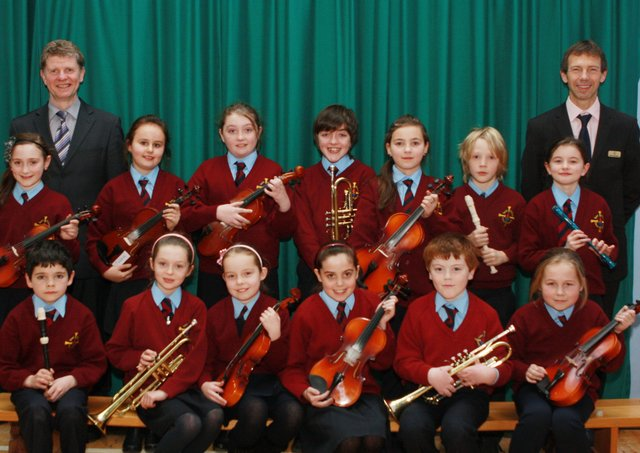 St. Eithnes PS pupils who have recently achieved music awards from Trinity College of Music, London.  The students are pictured here with school priocipal Mr Cosgrove and music teacher Mr Gormley.  (0312JB04)