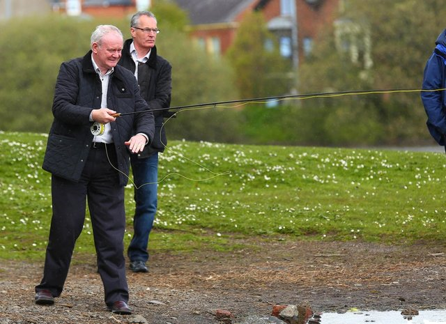 2015: Martin McGuinness and Gerry Kelly fishing. (Kevin Scott / Presseye)