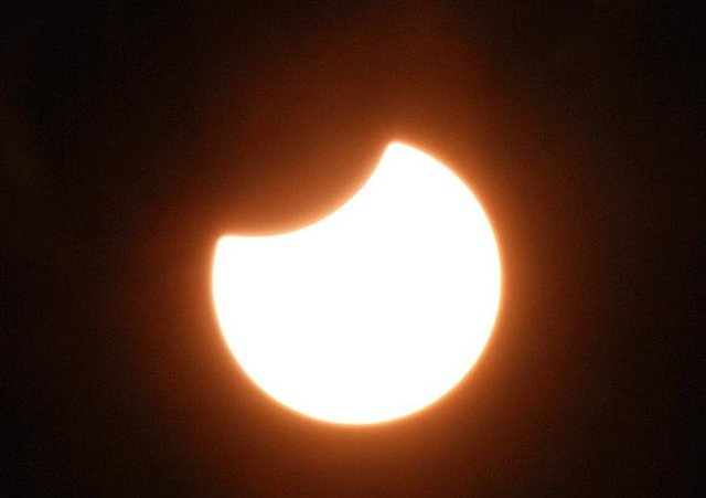 A previous partial solar eclipse. 21 year old Michael Barkley took the photograph from his front garden in the Belfast Road area. CT33-711